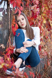 Young girl in beautiful autumn park, concept autumn. Autumn girl playing in city park stock photos