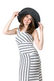 Young girl with a beautiful figure in a black hat Stock Photos