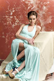 Young girl with beautiful hair in a long blue dress and platform sandals Stock Photo