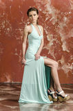Young girl with beautiful hair in a long blue dress and platform sandals Royalty Free Stock Image