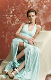 Young girl with beautiful hair in a long blue dress and platform sandals Royalty Free Stock Photography