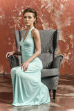 Young girl with beautiful hair in a long blue dress and platform sandals. Posing Royalty Free Stock Photo