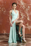 Young girl with beautiful hair in a long blue dress and platform sandals. Posing Stock Image