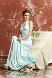 Young girl with beautiful hair in a long blue dress and platform sandals Stock Photos