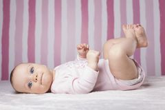 Beautiful infant portrait on colorful background. Royalty Free Stock Photography