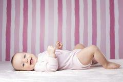 Beautiful infant portrait on colorful background. stock photo