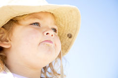 Young girl. A beautiful young girl staring into the distance with sand on her face Royalty Free Stock Photography