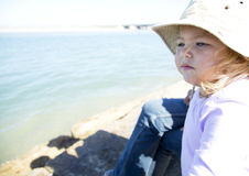 Young girl. A beautiful young girl in thought next to the river Stock Photography