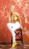 Young girl in beautiful underwear and jeans and posing playfull Stock Images