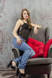Young girl in beautiful underwear and jeans and posing playfull Royalty Free Stock Image