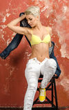 Young girl in beautiful underwear and jeans and posing playfull Royalty Free Stock Photography
