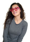 Young girl beauty portrait, black and white checkered dress, pink sunglasses in heart shape, long curly hair, glamour concept, iso Stock Image