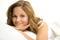 Young girl in bed royalty free stock photo