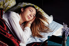 Young girl in bed in the morning with a Cup of coffee Stock Photo