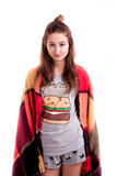Young girl in bedclothes covered with blanket posing Royalty Free Stock Images