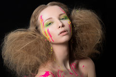 Young girl bedraggled with colorful dye Royalty Free Stock Image