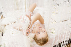 Young girl in bedroom Stock Photo