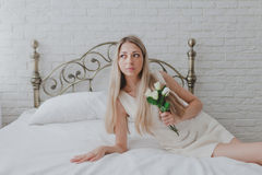 Young girl in bedroom Stock Image