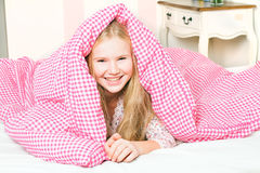 Young girl in the bedroom Royalty Free Stock Photo