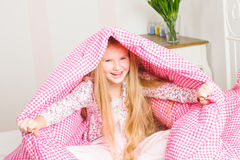 Young girl in the bedroom Stock Photography