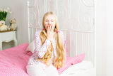 Young girl in the bedroom Stock Image