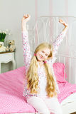 Young girl in the bedroom Royalty Free Stock Image