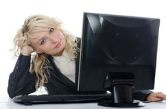 The young girl behind the computer Royalty Free Stock Images
