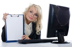 The young girl behind the computer Stock Images