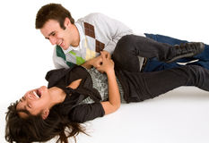 Young Girl being Tickled by Young Man royalty free stock photography