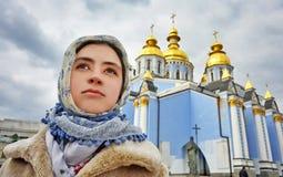 Young girl believer. Kiev, Ukraine royalty free stock image