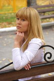 Young girl on a bench Stock Photography
