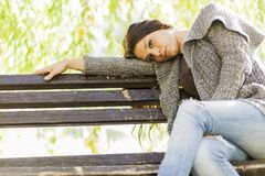 Young girl on the bench Royalty Free Stock Images