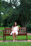 Young girl on bench Royalty Free Stock Image