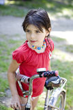 Young girl on the bicycle Royalty Free Stock Images