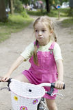 Young girl on the bicycle Royalty Free Stock Image