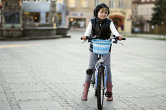 Young girl and a bicycle Stock Images