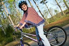 Young Girl on Bicycle Stock Photo