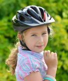 Young girl in a bicycle helmet. Royalty Free Stock Images