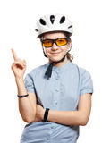 Young girl in bicycle helmet points to space, isolation on white. Young girl in white bicycle helmet points to space, isolation on white Royalty Free Stock Photography