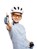 Young girl in a bicycle helmet shows gesture OK,  isolated on white. Young girl in white bicycle helmet shows gesture OK,  isolated on white Royalty Free Stock Photography