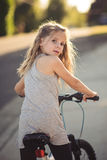 Young girl on a bicycle Stock Photo