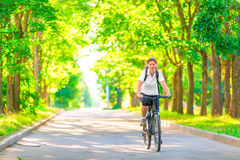 Young girl on a bicycle in a park Royalty Free Stock Photos