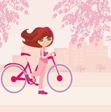 Young girl with bicycle Stock Photo