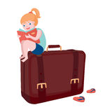 Young girl with a big bag. Girl is sitting on a bag at beginning of the journey Stock Photo