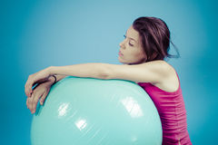 Young girl with big blue fit ball, on white chroma background Stock Photos