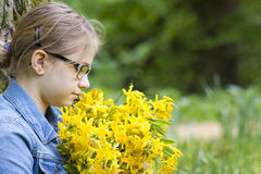 Young girl with big bouquet of spring flowers Royalty Free Stock Photos