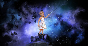 Young Girl, Big Dreams, Hope. A Young girl gazes at the stars in the sky and gets peace, hope, and inspiration for big dreams Royalty Free Stock Photos