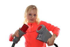 Young girl with big electrical plug Royalty Free Stock Photos