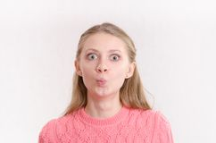Young girl with big eyes and wonder Stock Images