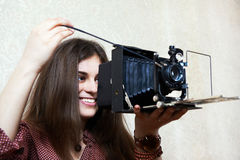 Young girl with old camera rarity Royalty Free Stock Photography